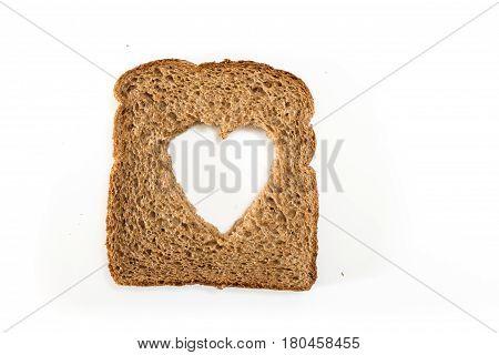 Whole Grain Sandwich Bread Slice With Heart Cut Shape, On White Background.