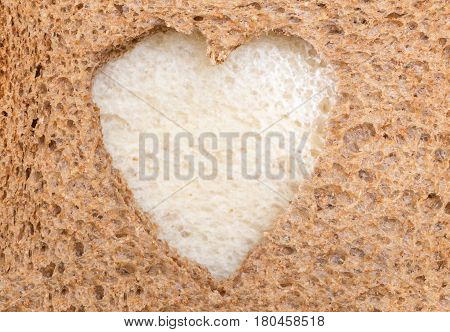 Whole Grain Sandwich Bread Slice With Heart Cut Shape And White Bread Slice Inside.