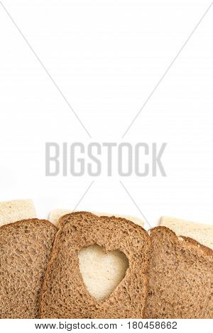 Sandwich Bread Slices With Heart Cut Shape, On White Background.
