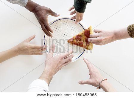 People Hands Grabbing Last Slice of Pizza