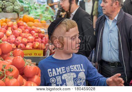 Undefined Orthodox Jewish Boy At Mahane Yehuda Market, Popular Marketplace In Jerusalem, Israel