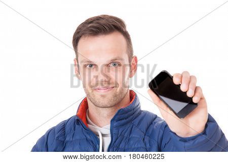 Attractive young man holding smart phone. All on white background.