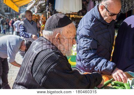 Undefined Orthodox Jewish Man Purchase Meal At Mahane Yehuda Market, Popular Marketplace In Jerusale