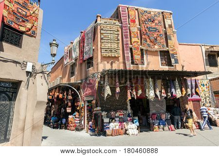 MARRAKESH MOROCCO - APR 29 2016: Tourist shops with traditional moroccan textile for sale in the souks of Marrakech.