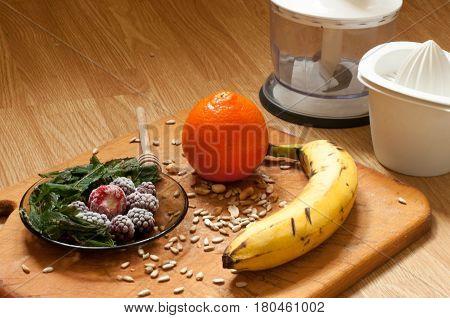 Banana, Orange,frozen Strawberries Blackberries And Seeds Vivid Smoothie Ingredients And Blender, Ju