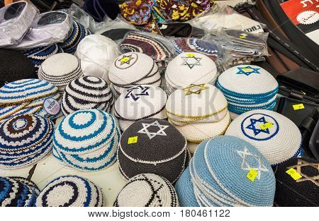 JERUSALEM ISRAEL - MARCH 31 2017: Lot of traditional jewish headwears (Kippah) for sale