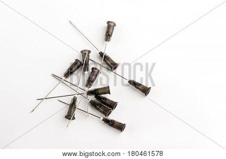 used needles of syringes, white isolated closeup