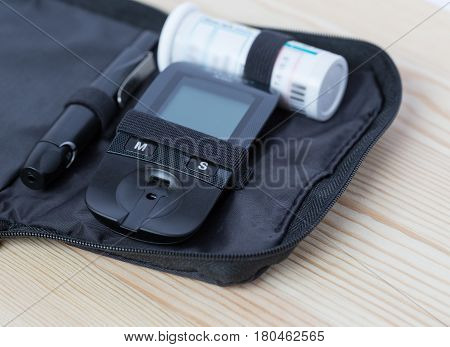 Glucometer and test strip lies in  bag case
