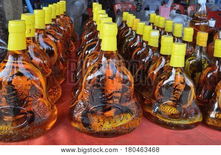 Alcohol tinctures on snakes and scorpions exotic bazaar on the island of the Mekong River Laos