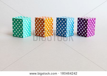 Colorful blocks polka dot pattern. Violet green orange blue color rectangular abstract boxes arranged on gray background. Modern geometrical design template. Copy space photo.