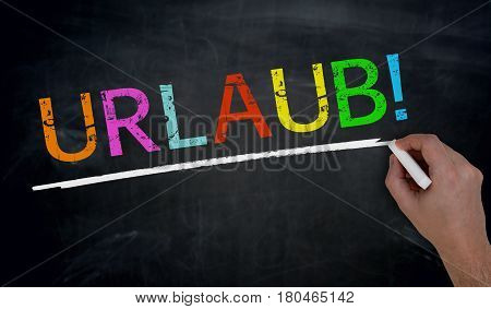 Urlaub (in German Holiday) Is Written By Hand On Blackboard