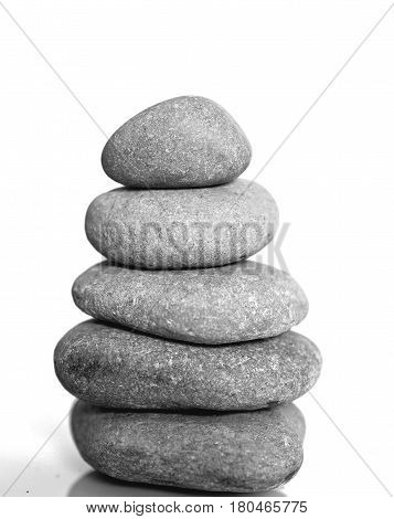 Zen spa stones isolated on white background. Balanced stones background with copy space. Spa symbol. Beautiful picture. Symbol of stability. Stones pile background.