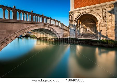 Bridge Canal and Doge's Palace Illuminated by Rising Sun at Sunrise Venice Italy
