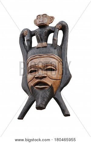A Carved Tribal Wooden Face Mask and Monkey.