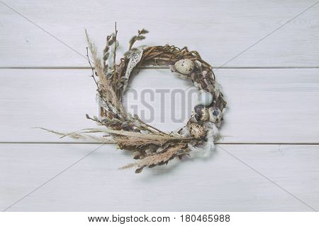 Wreath With Willow And Eggs On Wooden Background