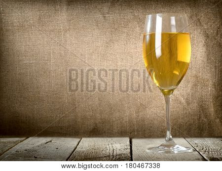 White wine glass on the wooden table