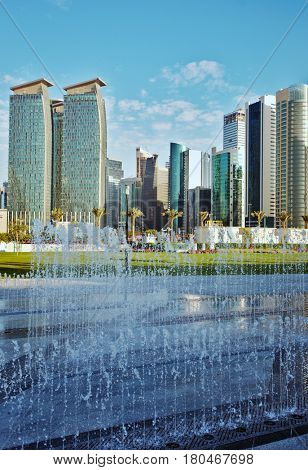 DOHA, QATAR - FEBRUARY 17, 2016: The high-rise district of Doha, seen from the recently completed Hotel Park, with fountains in the foreground