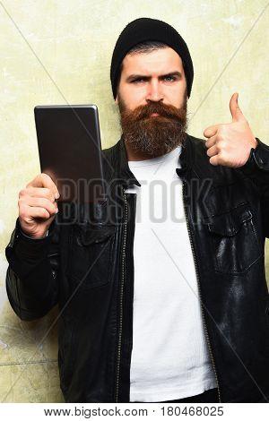 Bearded Brutal Caucasian Hipster Holding Tablet