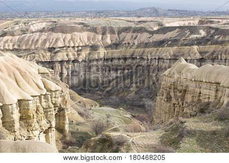 Pigeon valley - scenic canyon at the bottom of which is paved pedestrian trail between towns of Goreme and Uchisar. Cappadocia Turkey