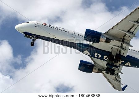 Saint Martin Dutch Antilles March 21 2017: Delta Airlines jet begins its ascend to the sky having just taken off from Princess Juliana airport.