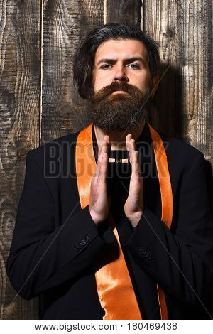 Caucasian Hipster In Suit Holding Perfume
