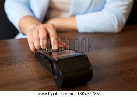 Woman Entering Pin Number