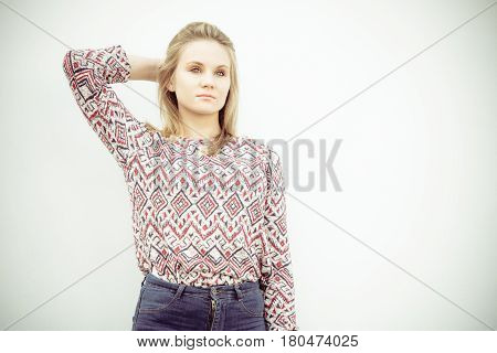 Fashion and style. Beauty young blondie woman posing outdoors. Gorgeous fashionable model wearing stylish clothes.