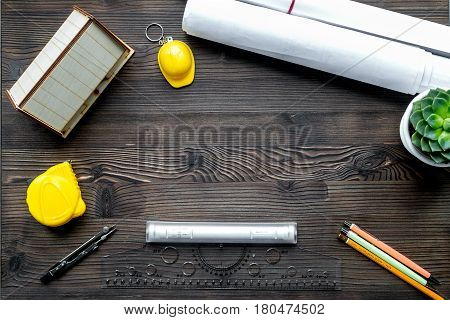 Construction office with architect working tools on wooden table background top view mock up