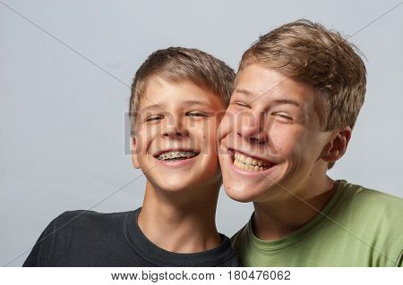 Two Boys, Cheeks Touching Making Funny Faces