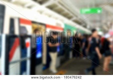 blurred photo, Blurry image, people At station Electric train ,background