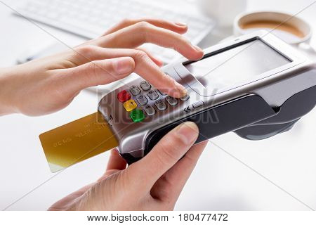 Credit card payment by terminal for business lunch in cafe on white table background