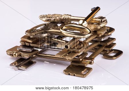 gold-plated blank keys laid out in the form of the draw-well, white isolated closeup