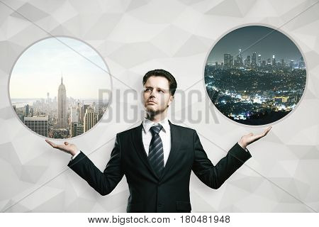 Handsome young businessman holding abstract round windows with daytime and night city views. Lifestyle choice concept