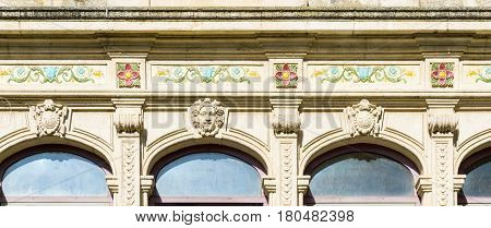 Ornate traditional architectural facade or frieze on city building France.