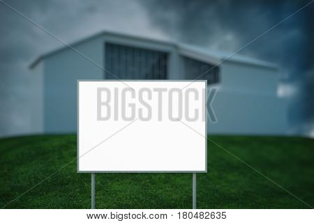 Empty blank poster with small house and dull sky in the background. Mortgage concept. Mock up 3D Rendering