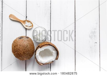 natural coconut oil for body care in organic cosmetic concept on white desk background top view