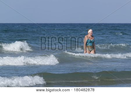 Middle-aged Woman Comes Out Of The Sea