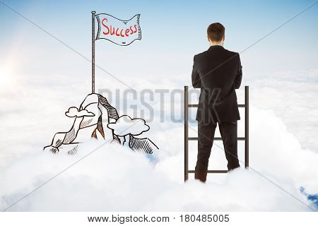 Back view of young businessman with creative mountain peak and flag sketch standing on top of ladder above clouds. Sky background. Success concept
