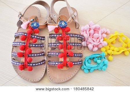 greek leather sandals with colorful pom pom - summer accessories advertisement