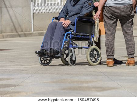 disabled person in a wheelchair on a city street