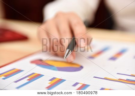 Businesswoman Monitoring Stock Statistics