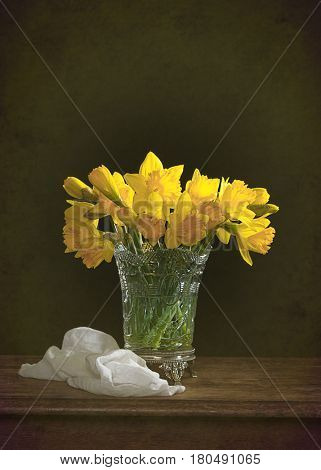 Still life with spring daffodil flowers on rustic table