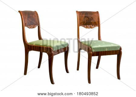 Antique Biedermeier chair isolated with green fabric and wood carving