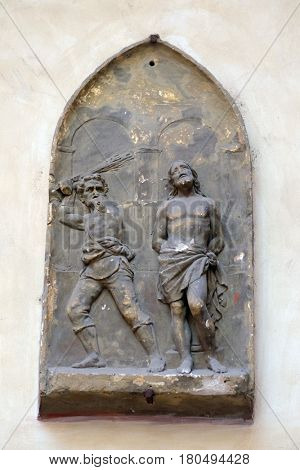 ROME, ITALY - SEPTEMBER 03: Flagellation of Christ, bass relief in Basilica of Saint Sylvester the First (San Silvestro in Capite) in Rome, Italy on September 03, 2016.