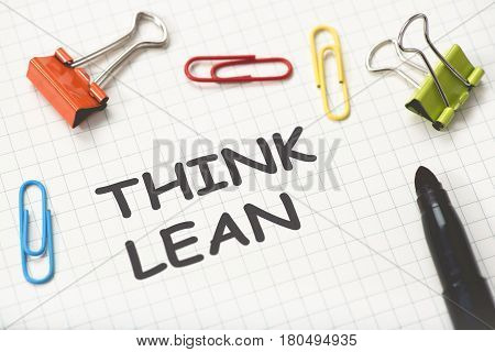 Lean Thinking Concept On Paper With Fastener Gadgets