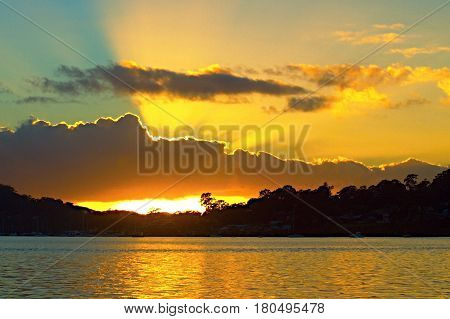 Golden waterscape dawn over water with reflections. Australia. sunrise sunrise photo sunbeams sun dawn rays angel rays crepuscular rays atmosphere seascape waterscape water ocean water reflections sky sky art gold blue daylight sunlight nature beauty in n
