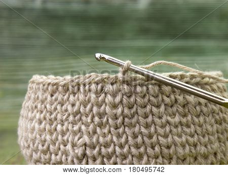 Linen rustic crochet box and steel crochet hook. Natural crochet textile tutorial pattern. Thick ribbon cotton yarn