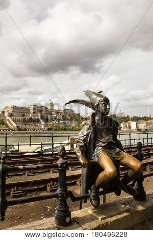The Little Princess statue on the Danube Promenade in Budapest, Hungary.