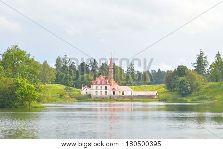 Priory park with lake and Prioratsky Palace in Gatchina Russia.