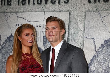 LOS ANGELES - APR 4:  Paris Hilton, Chris Zylka at the Premiere Of HBO's